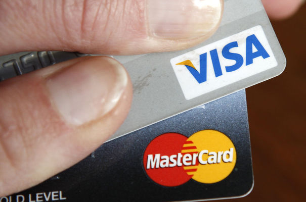 102733_a-consumer-holds-her-credit-cards-in-washington